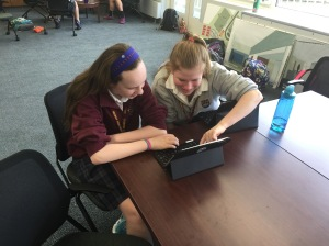 Brooke and Izzy prepare resources for the August 14 iPad Orientation.